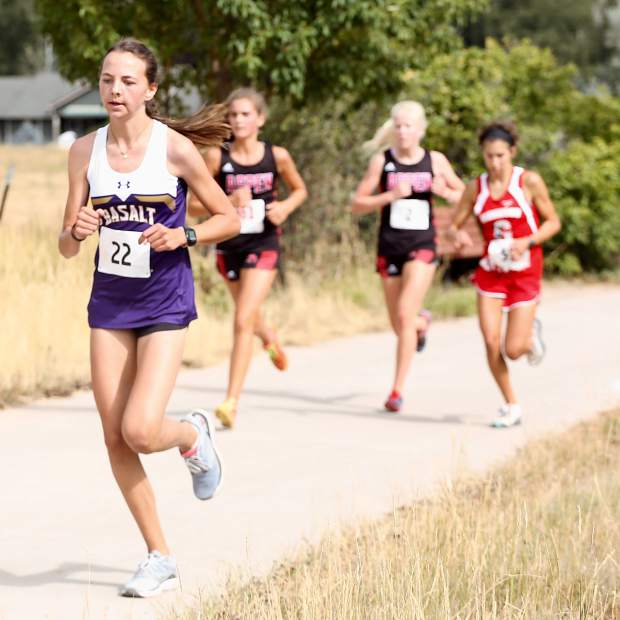 Basalt High School freshman Katelyn Maley, far left, competes in the Longhorn Invitational on Saturday, Aug. 24, 2019, at Crown Mountain Park. (Photo by Austin Colbert/The Aspen Times)