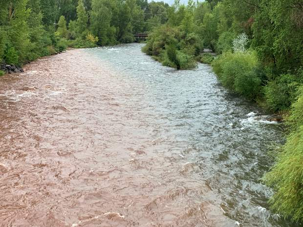The confluence where the Fryingpan River comes into the Roaring Fork River in Basalt shows a mix of mud and debris Sunday after the flash flooding on Basalt Mountain.