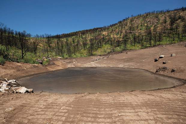 The catch basin above Pinon Drive in Basalt was full of mud on Monday after the Sunday rainstorm causing flash flooding.