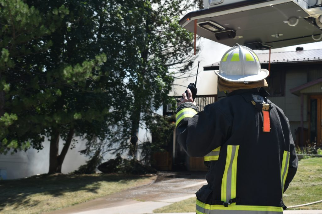 A firefighter responds to a house fire in Glenwood Springs Tuesday, Aug. 20.
