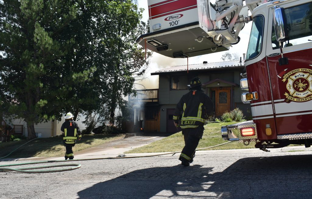 Firefighters respond to a house fire in Glenwood Springs Tuesday, Aug. 20.