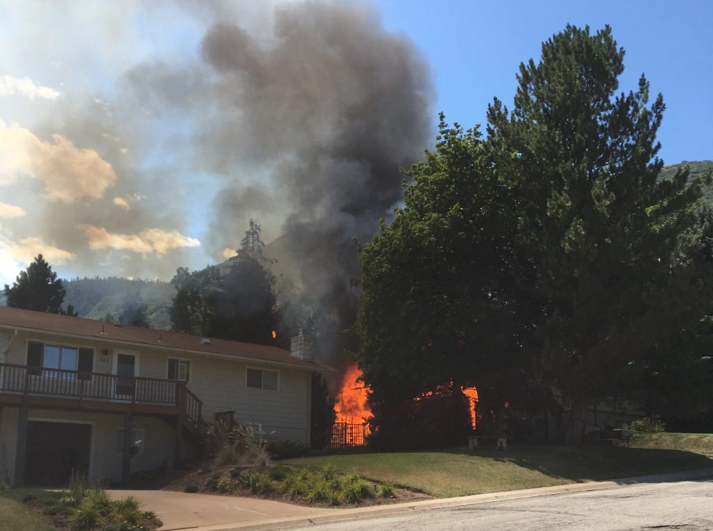 A neighbor took a picture of the house fire in Glenwood Springs before fire crews arrived.