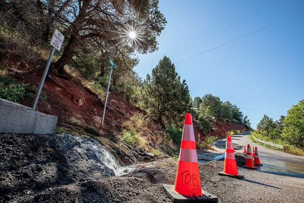 Flash flood debris diverted from a basin on Monday at Pinon and Cedar Drive.