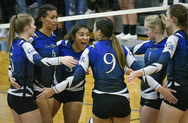 Coal Ridge celebrates a point during game two of their match against Basalt Thursday in New Castle.