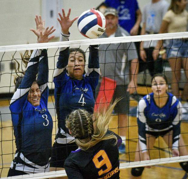 Coal Ridge's Ari Cornejo, left, and Maya Mercado block the shot attempt by Basalt's Lecsi Glenn during game one of the match Thursday in New Castle.