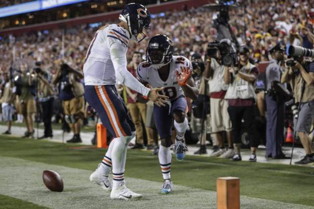 Chicago Bears quarterback Mitchell Trubisky, left, celebrates after connecting with wide receiver Taylor Gabriel (18) for a touchdown during the first half of an NFL football game against the Washington Redskins, Monday, Sept. 23, 2019, in Landover, Md. (AP Photo/Julio Cortez)