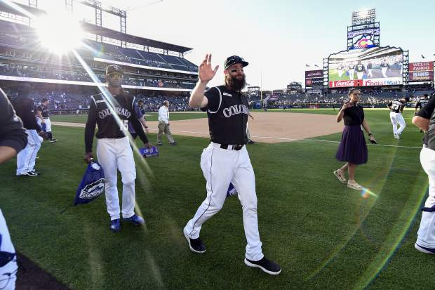 Colorado Rockies right fielder Charlie Blackmon (19) waves to the crowd thanking the fans after their win over the Milwaukee Brewers 4-3 in 13 innings at a baseball game Sunday, Sept. 29, 2019, in Denver. (AP Photo/John Leyba)