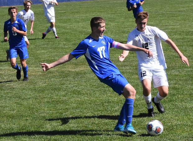 Coal Ridge senior Landon Stickler passes the ball back to a teammate during Saturday's game against Mullen in New Castle. Coal Ridge fell to Mullen 3-0.