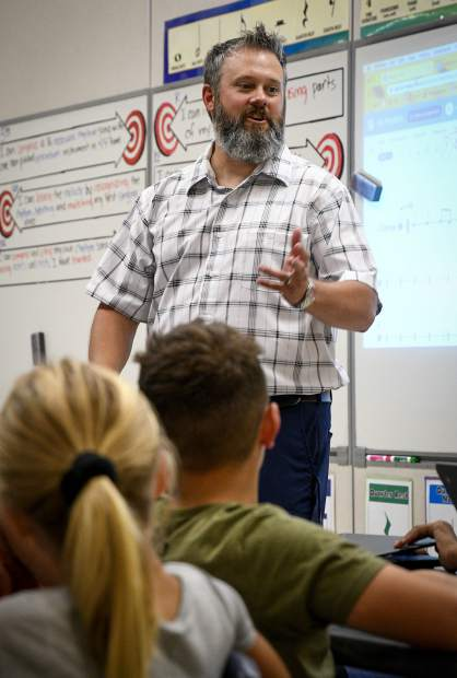 Justin Bankey teaches composition to a fifth grade class Tuesday in Silt. Bankey the music teacher at Cactus Valley Elementary School, recently found out he was one of seven finalist for Colorado Teacher of the Year.