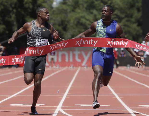 FILE - In this June 30, 2019, file photo, Christian Coleman, left, of the United States, wins the 100-meter race as he looks towards compatriot Justin Gatlin during the Prefontaine Classic athletics meet in Stanford, Calif. Now that Usain Bolt's gone, the top two contenders in the 100-meter final are expected to be Coleman and defending champion Justin Gatlin. (AP Photo/Jeff Chiu, File)
