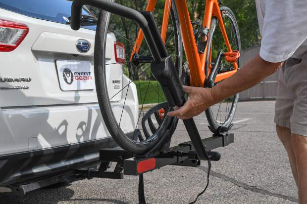 Eric Sampson straps his bike into his Event Gear bike rack.
