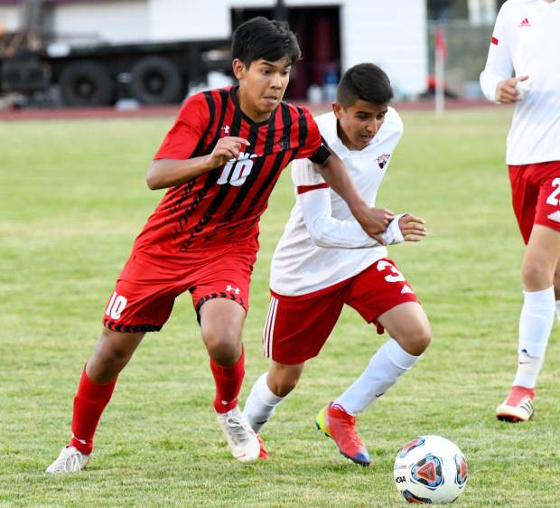 Glenwood Springs Demon Alan Videla dribbles the ball past the defending Montrose Indians in a Sept. 12 1-0 win at home.