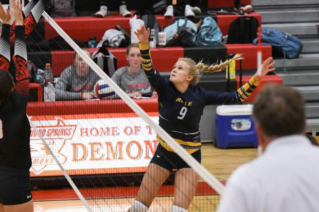 Rifle Bear Sage Allen jumps to get the ball over the net against the Glenwood Springs Demons on Tuesday night.