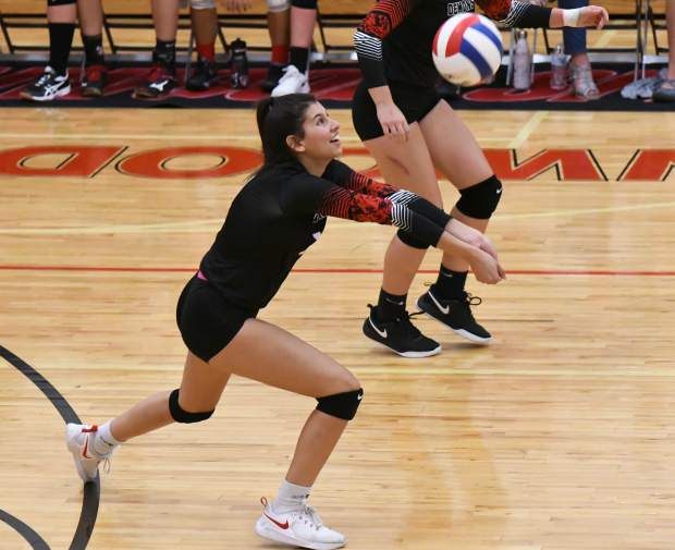 Glenwood Springs Demon Shanik Zambrano sets the ball during Tuesday night's home game against the Rifle Bears.
