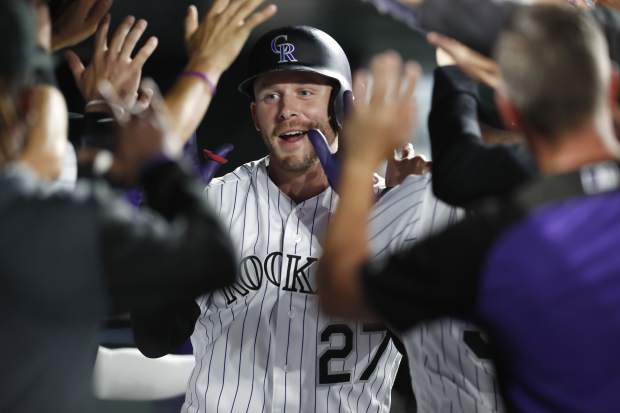 Colorado Rockies' Trevor Story is congratulated as he returns to the dugout after hitting a two-run home run off New York Mets starting pitcher Steven Matz in the fourth inning of a baseball game Monday, Sept. 16, 2019, in Denver. (AP Photo/David Zalubowski)