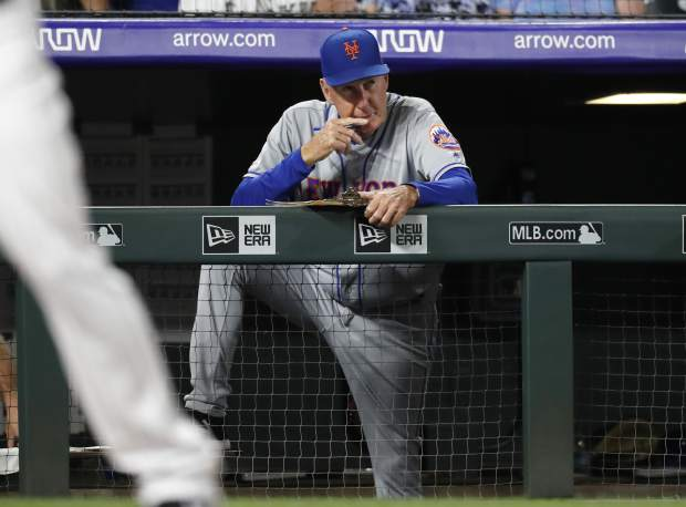 New York Mets interim pitching coach Phil Regan looks on as relief pitcher Walker Lockett works against the Colorado Rockies in the fifth inning of a baseball game Monday, Sept. 16, 2019, in Denver. (AP Photo/David Zalubowski)