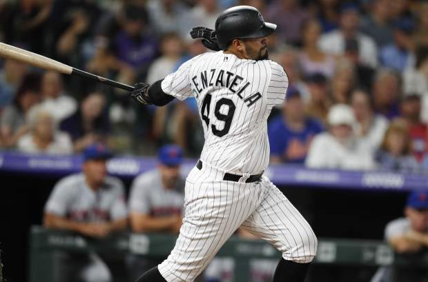 Colorado Rockies' Antonio Senzatela connects for a single to drive in two runs off New York Mets starting pitcher Steven Matz in the fourth inning of a baseball game Monday, Sept. 16, 2019, in Denver. (AP Photo/David Zalubowski)