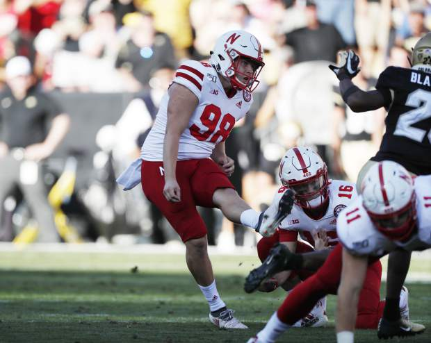 Nebraska place kicker Isaac Armstrong kicks but misses with his field goal attempt to tie the score in overtime of an NCAA college football game against Colorado Saturday, Sept. 7, 2019, in Boulder, Colo. Colorado won 34-31 in overtime. (AP Photo/David Zalubowski)