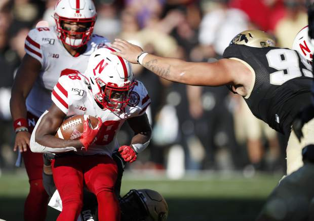 Colorado defensive tackle Jalen Sami, right, stops Nebraska running back Maurice Washington in overtime of an NCAA college football game Saturday, Sept. 7, 2019, in Boulder, Colo. Colorado won 34-31 in overtime. (AP Photo/David Zalubowski)
