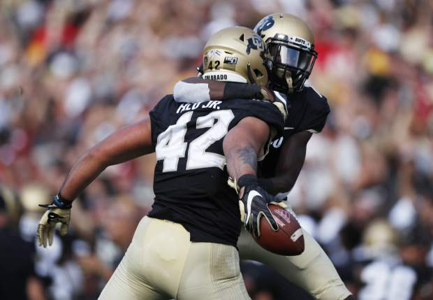 Colorado linebacker Nu'umotu Falo Jr. (42) celebrates after he recovered a fumble with cornerback Delrick Abrams Jr. in the second half overtime of an NCAA college football game against Nebraska Saturday, Sept. 7, 2019, in Boulder, Colo. Colorado won 34-31 in overtime. (AP Photo/David Zalubowski)