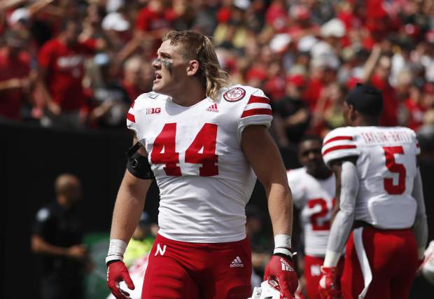 Nebraska linebacker Garrett Nelson responds to the cheers of the crowd before the first half of an NCAA college football game against Colorado Saturday, Sept. 7, 2019, in Boulder, Colo. (AP Photo/David Zalubowski)