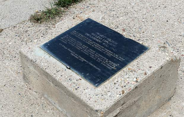 High in the mountains southeast of Parachute, Colo., a plaque marks the site of the Project Rulison nuclear test that took place on Sept. 10, 1969. The plaque reads, in part,