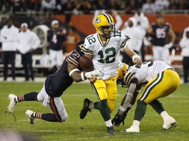 Chicago Bears' Ha Ha Clinton-Dix strips the ball from Green Bay Packers' Aaron Rodgers during the second half of an NFL football game Thursday, Sept. 5, 2019, in Chicago. Rodgers revered the fumble. (AP Photo/Charles Rex Arbogast)