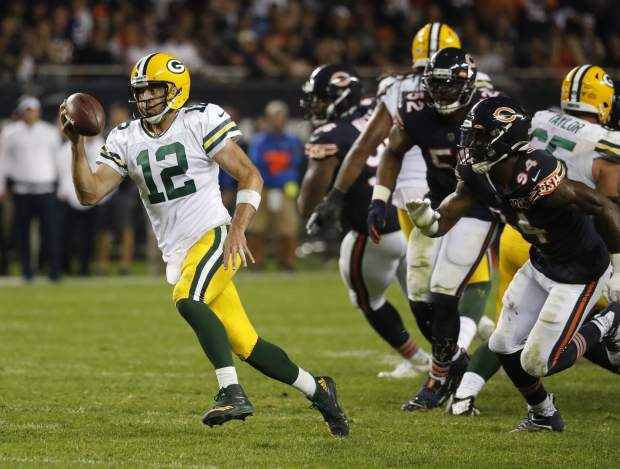 Green Bay Packers' Aaron Rodgers runs during the second half of an NFL football game against the Chicago Bears Thursday, Sept. 5, 2019, in Chicago. (AP Photo/Charles Rex Arbogast)