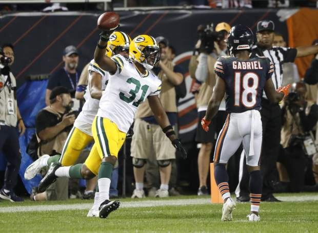 Green Bay Packers' Adrian Amos reacts after intercepting a pass during the second half of an NFL football game against the Chicago Bears Thursday, Sept. 5, 2019, in Chicago. The Packers won 10-3. (AP Photo/Charles Rex Arbogast)