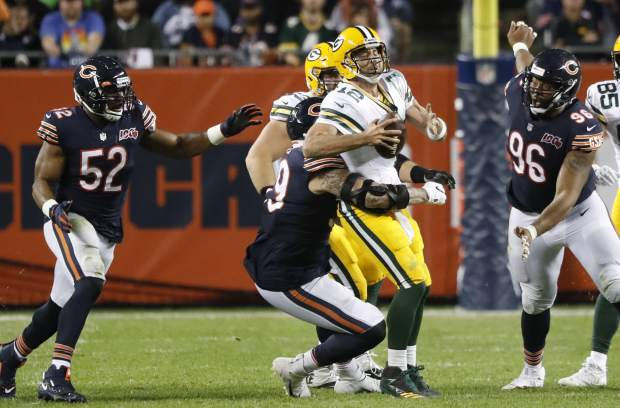 Green Bay Packers' Aaron Rodgers is sacked by Chicago Bears' Aaron Lynch during the second half of an NFL football game Thursday, Sept. 5, 2019, in Chicago. (AP Photo/Charles Rex Arbogast)