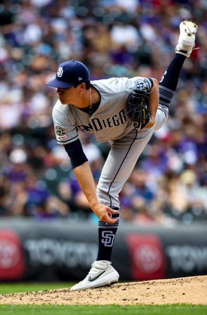 San Diego Padres starting pitcher Cal Quantrill throws in the third inning of a baseball game against the Colorado Rockies, Sunday, Sept. 15, 2019, in Denver. (AP Photo/Parker Seibold)/The Gazette via AP)