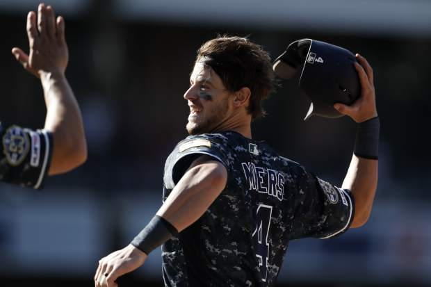 San Diego Padres' Wil Myers celebrates after hitting a walkoff RBI-single during the tenth inning of a baseball game against the Colorado Rockies, Sunday, Sept. 8, 2019, in San Diego. The Padres won, 2-1. (AP Photo/Gregory Bull)