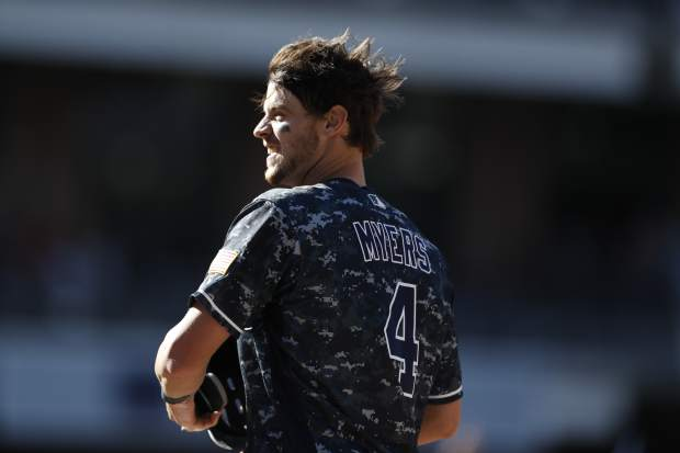 San Diego Padres' Wil Myers celebrates after hitting a walkoff RBI-single during the tenth inning of a baseball game against the Colorado Rockies Sunday, Sept. 8, 2019, in San Diego. The Padres won, 2-1. (AP Photo/Gregory Bull)