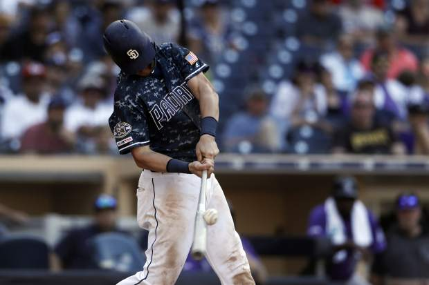 San Diego Padres' Wil Myers hits a walkoff single during the tenth inning of a baseball game against the Colorado Rockies, Sunday, Sept. 8, 2019, in San Diego. (AP Photo/Gregory Bull)