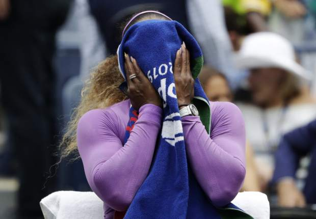 Serena Williams, of the United States, wipes sweat off her face between games during the women's singles final against Bianca Andreescu, of Canada, at the U.S. Open tennis championships Saturday, Sept. 7, 2019, in New York. (AP Photo/Adam Hunger)