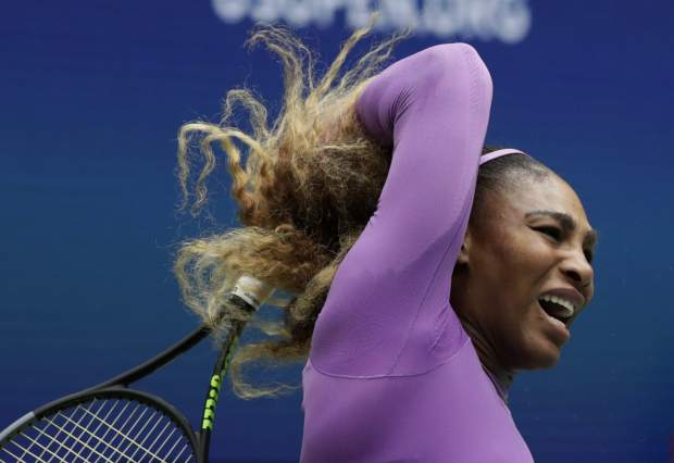 Serena Williams, of the United States, returns a shot to Bianca Andreescu, of Canada, during the women's singles final of the U.S. Open tennis championships Saturday, Sept. 7, 2019, in New York. (AP Photo/Adam Hunger)