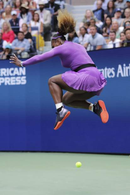 Serena Williams, of the United States, leaps as a shot from Bianca Andreescu, of Canada, falls during the women's singles final of the U.S. Open tennis championships Saturday, Sept. 7, 2019, in New York. (AP Photo/Charles Krupa)