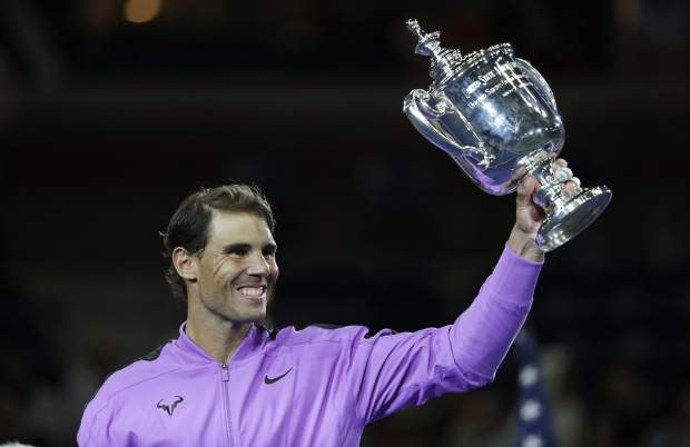 Rafael Nadal, of Spain, holds up the championship trophy after defeating Daniil Medvedev, of Russia, to win the men's singles final of the U.S. Open tennis championships Sunday, Sept. 8, 2019, in New York. (AP Photo/Adam Hunger)