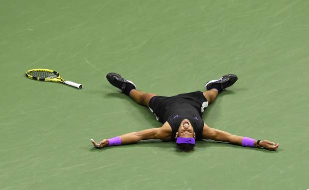 Rafael Nadal, of Spain, reacts after defeating Daniil Medvedev, of Russia, to win the men's singles final of the U.S. Open tennis championships Sunday, Sept. 8, 2019, in New York. (AP Photo/Sarah Stier)