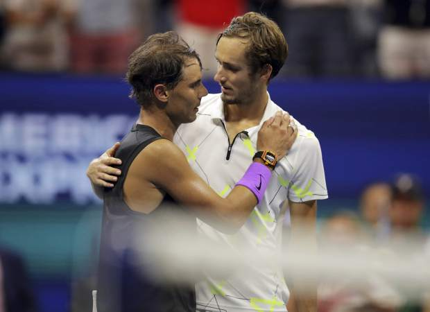 Daniil Medvedev, of Russia, congratulates Rafael Nadal, of Spain, after Nadal won the men's singles final of the U.S. Open tennis championships Sunday, Sept. 8, 2019, in New York. (AP Photo/Charles Krupa)