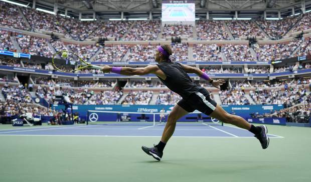 Rafael Nadal, of Spain, returns a shot to Daniil Medvedev, of Russia, during the men's singles final of the U.S. Open tennis championships Sunday, Sept. 8, 2019, in New York. (AP Photo/Eduardo Munoz Alvarez)