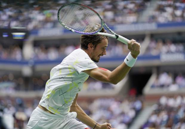 Daniil Medvedev, of Russia, returns a shot to Rafael Nadal, of Spain, during the men's singles final of the U.S. Open tennis championships Sunday, Sept. 8, 2019, in New York. (AP Photo/Eduardo Munoz Alvarez)