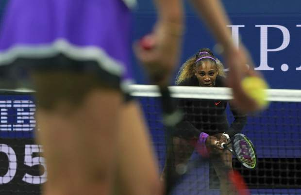 Serena Williams, of the United States, waits for the serve from Elina Svitolina, of Ukraine, during the semifinals of the U.S. Open tennis championships Thursday, Sept. 5, 2019, in New York. (AP Photo/Eduardo Munoz Alvarez)
