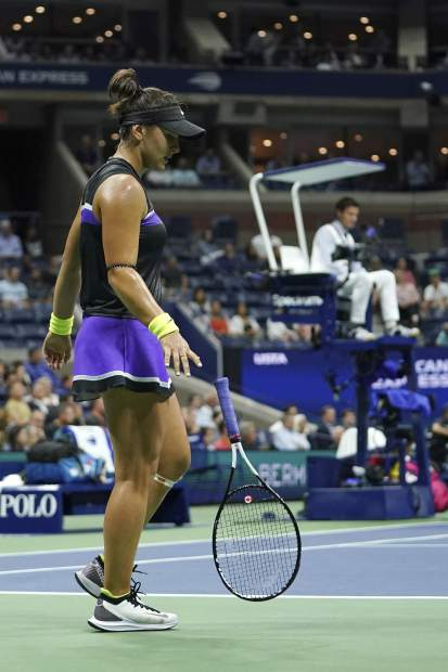 Bianca Andreescu, of Canada, throws her racket down onto the court after losing a point to Belinda Bencic, of Switzerland, during the semifinals of the U.S. Open tennis championships Thursday, Sept. 5, 2019, in New York. (AP Photo/Eduardo Munoz Alvarez)