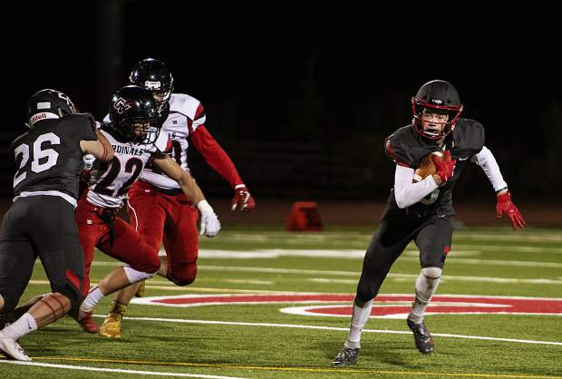 Aspen High School's Jack Seamans runs the ball during the homecoming game against Grand Valley High School in Aspen on Friday, September 27, 2019. (Kelsey Brunner/The Aspen Times)