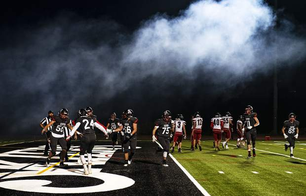 Smoke from the cannon billows over the field as the Aspen High School Skiers celebrate their first touchdown during the homecoming game against Grand Valley High School in Aspen on Friday, September 27, 2019. (Kelsey Brunner/The Aspen Times)