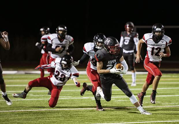 Aspen High School's Noah Akin (21) runs the ball during the homecoming against Grand Valley High School in Aspen on Friday, September 27, 2019. (Kelsey Brunner/The Aspen Times)