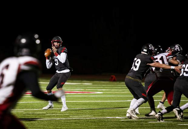 Aspen High School's quarterback Tyler Ward looks for an open pass during the game against Grand Valley High School in Aspen on Friday, September 27, 2019. (Kelsey Brunner/The Aspen Times)