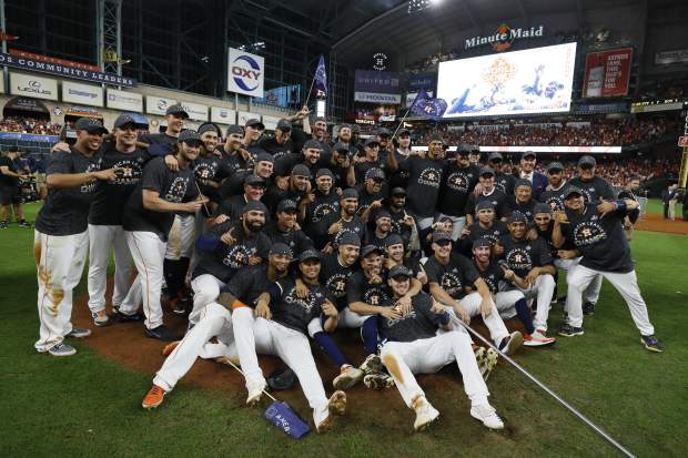 Houston Astros pose after winning Game 6 of baseball's American League Championship Series against the New York Yankees Saturday, Oct. 19, 2019, in Houston. The Astros won 6-4 to win the series 4-2. (AP Photo/Matt Slocum)