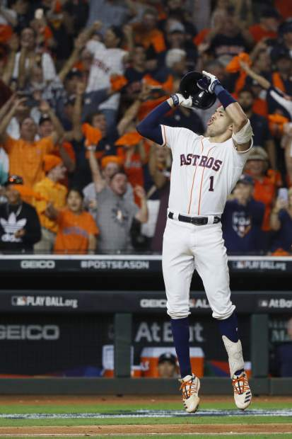 Houston Astros' Carlos Correa celebrates after his walk-off home run against the New York Yankees during the 11th inning in Game 2 of baseball's American League Championship Series Sunday, Oct. 13, 2019, in Houston. (AP Photo/Matt Slocum)
